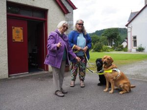 Marion and guide dog Willow were delighted to make new acquaintances on their way into church